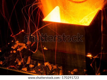 closeup on the combustion of an pellet stove - stock photo