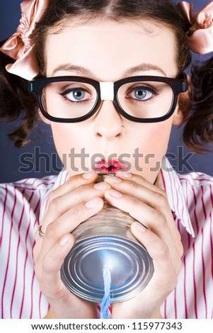 Closeup On The Face Of A Big Business Kid Making A Telephone Call Through Tin Cans - stock photo
