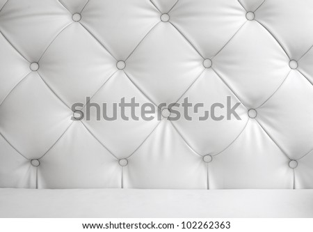 Closeup on White leather chair texture - stock photo