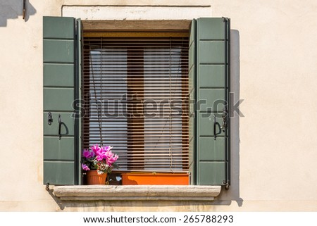 Closeup on windows windows of a typical Venetian house, Italy - stock photo