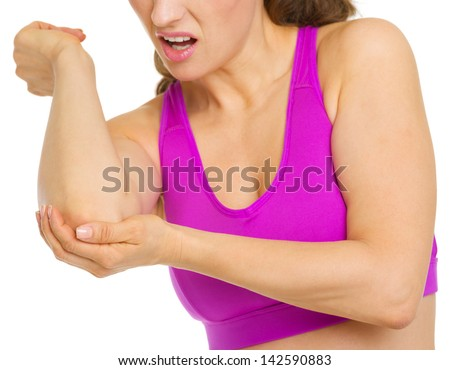 Closeup on woman with elbow pain - stock photo