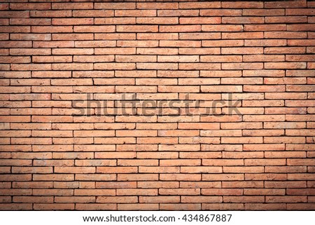 Closeup orange brick texture and brick background. Grunge retro vintage of brick wall. Part of old brick wall for design with copy space for text or image. Dark edged. - stock photo