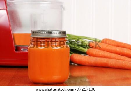 closeup organic carrot baby food - stock photo