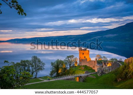 Closeup panoramic view of Urquhart Castle. The castle sits beside Loch Ness, near Inverness and Drumnadrochit, in the Highlands of Scotland. Only the tower of the castle is in focus; the rest is blur. - stock photo