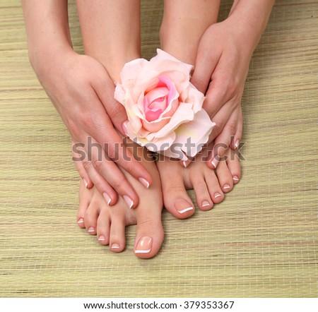 Closeup photo of a beautiful female feet with pedicure - stock photo