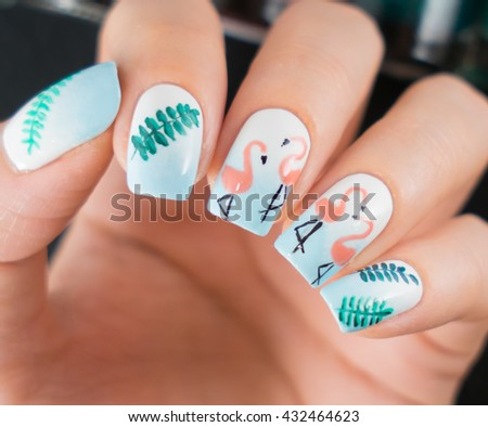 Closeup photo of a beautiful female hands with light nails - stock photo