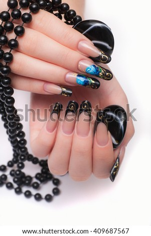Closeup photo of a beautiful female hands with nail design in the Russian style. Isolated on white background - stock photo