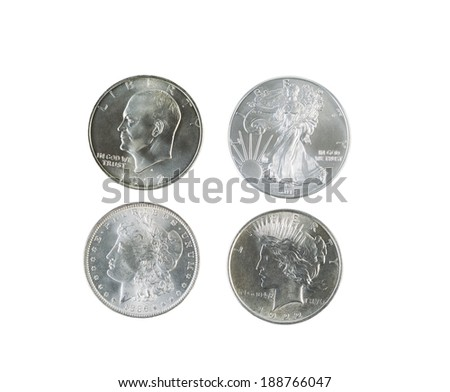 Closeup photo of a Morgan, Peace, Eisenhower and American Eagle Silver Dollars isolated white  - stock photo