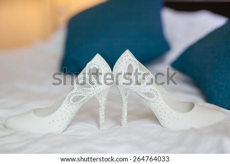 closeup photo of beautiful bride's shoes - stock photo