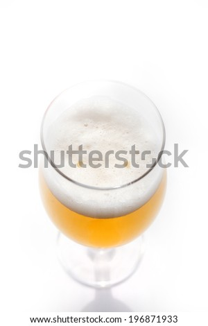 closeup photo of beer from above with two orange spots looking like smiling - stock photo