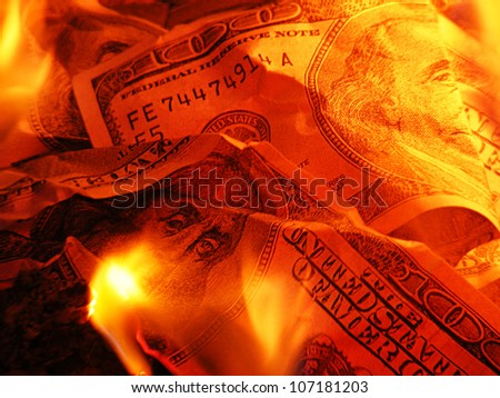 Closeup photo of burning dollars - stock photo
