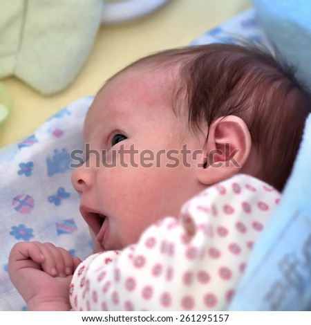 Closeup photo of little newborn baby girl, happy parenthood concept. Small depth of field. Soft focus image  - stock photo