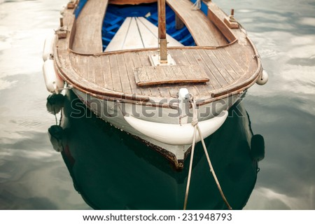 Closeup photo of moored old white wooden boat - stock photo