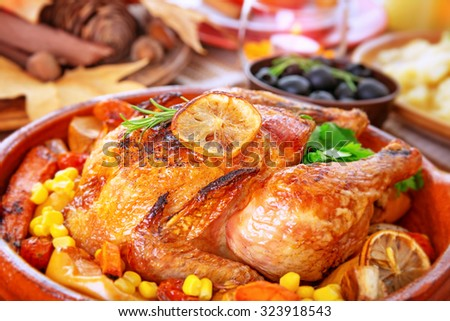 Closeup photo of tasty baked turkey in centerpiece of festive table, traditional food for Thanksgiving day holiday - stock photo