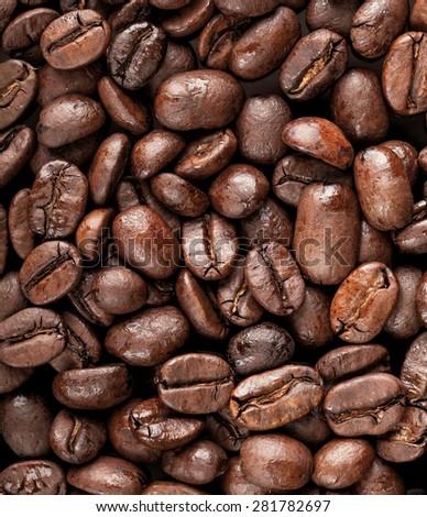 Closeup photo texture of dark rusted coffee beans - stock photo