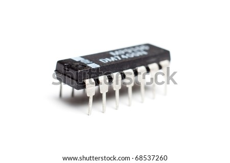 Closeup photograph of an single electronic integrated circuit chip on a white background - stock photo