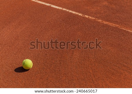 closeup photograph of tennis ball on the court - stock photo