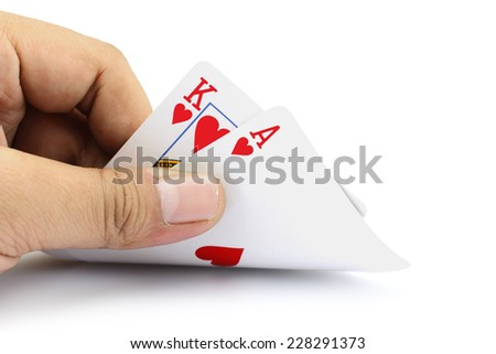 Closeup photos that focuses on the black jack with King card and ace card of heart in the hand on white background - stock photo