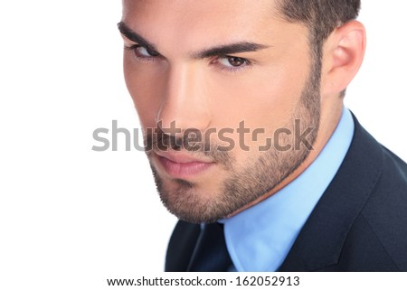 closeup picture of a serious young business man's face on white background - stock photo