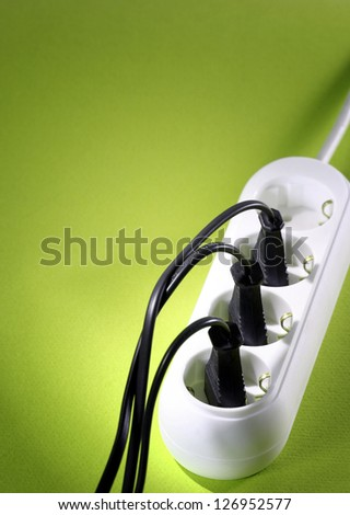 Closeup picture of a white outlet isolated on blue. - stock photo
