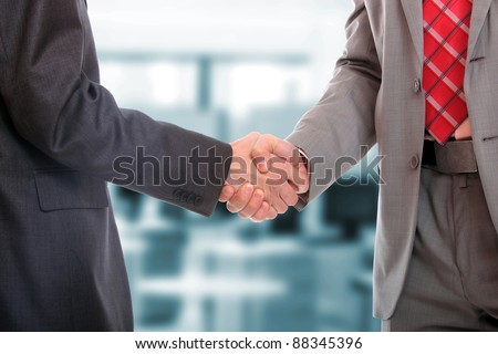 Closeup picture of businesspeople shaking hands, making an agreement. - stock photo