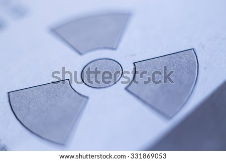 Closeup picture of Radiation Sign on the paper. - stock photo