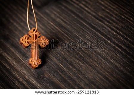 Closeup picture of small wooden christian cross - stock photo