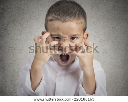 Closeup portrait angry child, Boy Screaming hysterical demanding, having nervous breakdown isolated grey wall background. Negative human Emotion Facial Expressions, body language, attitude, perception - stock photo