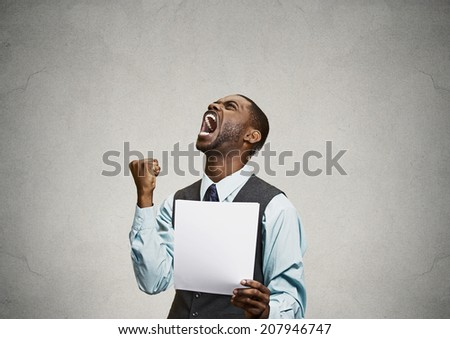 Closeup portrait angry, mad, screaming business man holding paper, document, screaming, looking up isolated grey background. Negative emotions, facial expressions, feeling. Financial crisis, bad news - stock photo