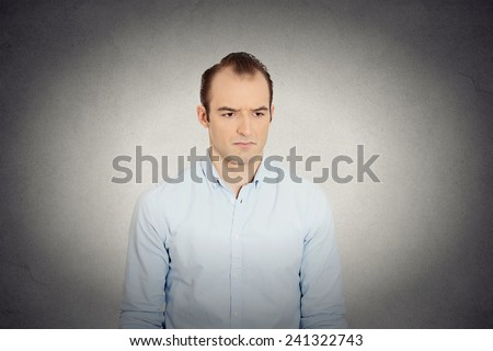 Closeup portrait angry sad annoyed, skeptical, grumpy business man employee worker isolated grey wall background. Human emotion face expression, reaction, feelings interpersonal conflict resolution - stock photo