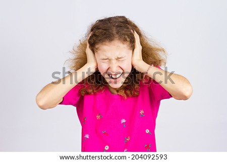 Closeup portrait angry upset, stressed little young girl, having nervous breakdown, screaming isolated grey background. Negative human emotion facial expression, feeling attitude, reaction perception - stock photo
