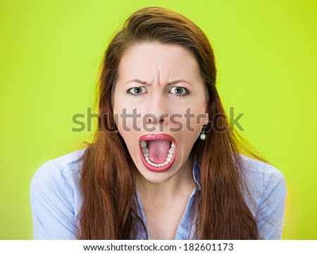 Closeup portrait  angry, upset, young business woman, student, worker accusing, screaming at you isolated green background. Negative human emotion facial expression, feeling symbol, attitude reaction - stock photo