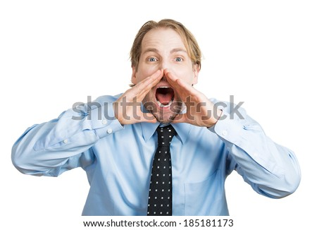 Closeup portrait angry, upset, young man, worker, mad employee, funny looking business man, hands to open mouth yelling, isolated white background. Negative emotions, facial expression, reaction - stock photo