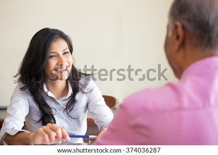 Closeup portrait, appointment with office manager, job interview, hiring, isolated indoors office background. Getting that first job or excellent customer service with a smile - stock photo