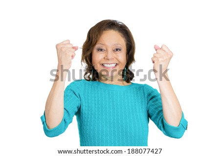Closeup portrait, beautiful excited, energetic, happy, senior mature woman winner, arms, fists pumped celebrating success, isolated white background. Positive human emotion, facial expression - stock photo