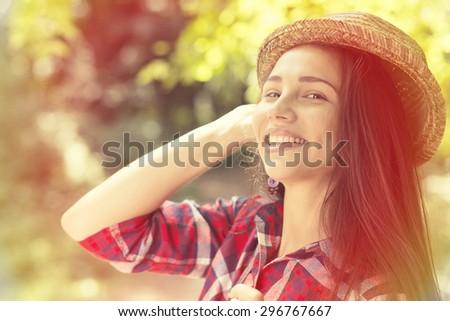 Closeup portrait beautiful happy woman enjoying summer day having fun in park. Positive human emotions feelings. Instagram filter effect applied  - stock photo