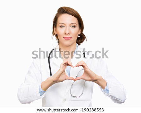 Closeup portrait, beautiful smiling cheerful health care professional, pharmacist, dentist, nurse making heart sign hands, isolated white background. Positive human emotion facial expression feeling - stock photo