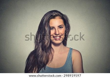Closeup portrait beautiful smiling woman isolated on gray wall background  - stock photo