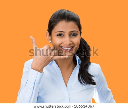 Closeup portrait, beautiful young woman showing call me phone hand sign gesture, smiling, happy, isolated orange background. Positive human emotion facial expression feelings, body language, symbols - stock photo