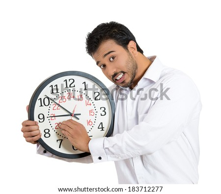 Closeup portrait business man, funny worker holding clock stressed, running out pressured by lack of time, trying to stop, hold it, late for meeting, isolated white background. Negative emotion - stock photo