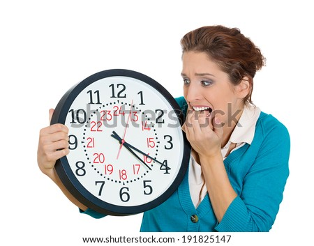 Closeup portrait business woman, wife, mother worker employee holding clock looking anxious, biting fingernails pressured by lack, running out of time isolated white background. Negative human emotion - stock photo