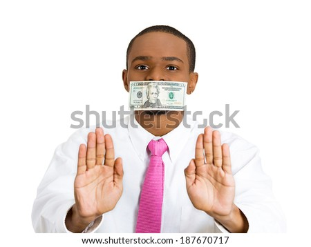 Closeup portrait, calm, young corrupt man with cash, dollar, money bill taped to mouth, showing stop sign isolated white background. Bribery concept in politics, business, diplomacy. Life perception - stock photo