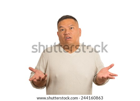 Closeup portrait dumb clueless man arms out asking why what's problem who cares so what I don't know isolated white background. Negative human emotion face expression feeling body language reaction - stock photo