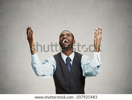 Closeup portrait excited, energetic, happy, screaming student, business man winning, arms, fists, hands pumped celebrating success isolated grey background. Positive human emotion facial expression - stock photo