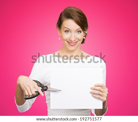 Closeup portrait, excited, happy, energetic enthusiastic young business woman, funny female, worker, dedicated employee cutting blank white paper, copy space with scissors isolated pink background. - stock photo
