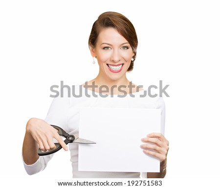 Closeup portrait, excited, happy, energetic enthusiastic young business woman, funny female, worker, dedicated employee cutting blank white paper, copy space with scissors isolated background. Emotion - stock photo