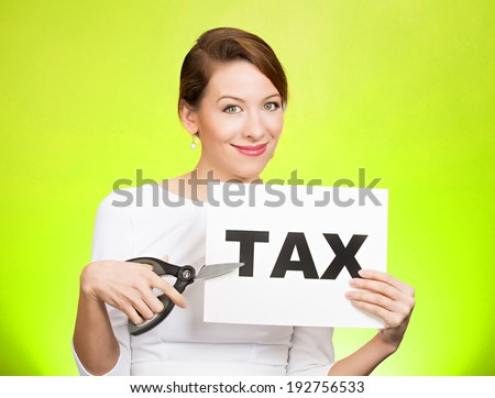 Closeup portrait excited, happy, smiling, energetic, enthusiastic young business woman, funny looking girl, worker, dedicated employee, cutting taxes with scissors, isolated green background. IRS. - stock photo