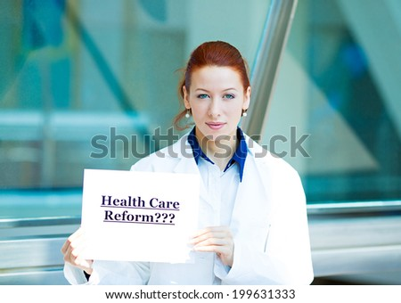 Closeup portrait female health care professional doctor with stethoscope holding sign health care reform? isolated hospital background. Obamacare, medicaid, legislation debate insurance plan coverage - stock photo