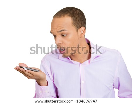 Closeup portrait, funny young man, shocked surprised, wide open mouth, by what he sees on his cell phone, isolated white background. Negative human emotions, facial expression feeling - stock photo