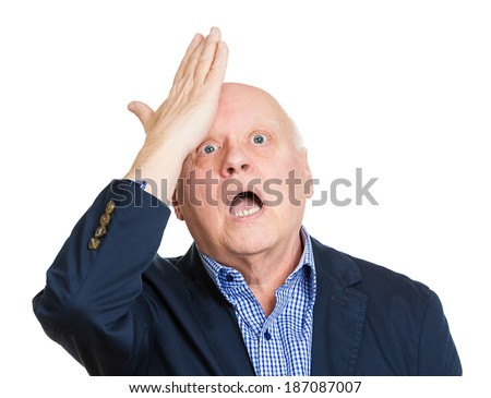Closeup portrait, goofy, funny face, senior mature man slapping hand on head to say duh, oops, isolated white background. Negative human emotion facial expression feelings, body language - stock photo